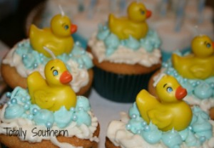 Cutely Decorated Vanilla Cupcakes with Duck Candles