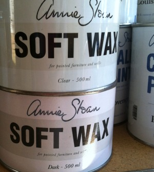 Containers of Annie Sloan Clear and Dark Wax
